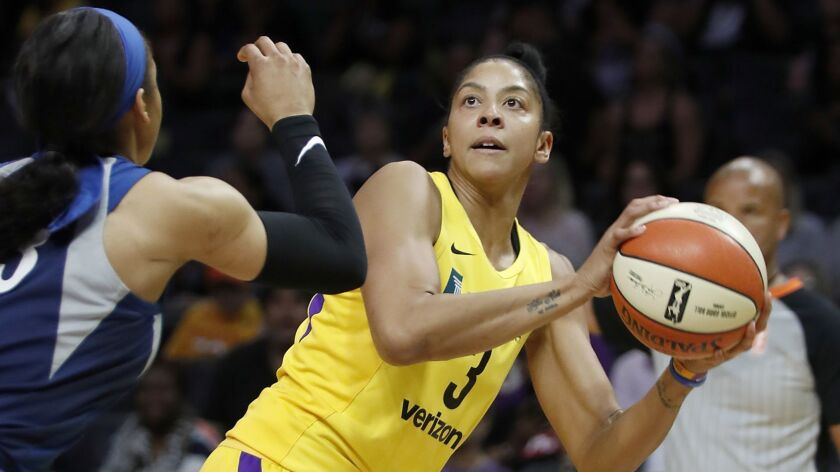 LOS ANGELES, CALIF. - AUG. 21, 2018. Sparks center Candace Parker shoots against Lynx forward Maya