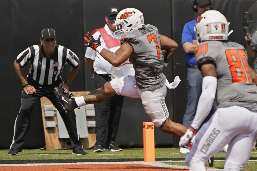Oklahoma State running back Jaylen Warren (7) runs into the endzone with a touchdown in the second half of an NCAA college football game against Tulsa, Saturday, Sept. 11, 2021, in Stillwater, Okla. (AP Photo/Sue Ogrocki)