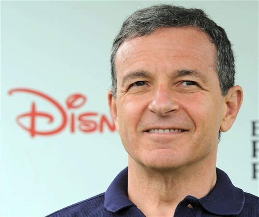 This June 12, 2011 photo shows Robert Iger arriving at The 22nd Annual A Time for Heroes Celebrity Carnival Sponsored by Disney at Wadsworth Theater in Los Angeles. Iger will remain in his job through March 2015 and then serve as executive chairman for another 15 months to help break in a new chief executive, according to an announcement Friday Oct. 7, 2011. (AP Photo/Katy Winn)