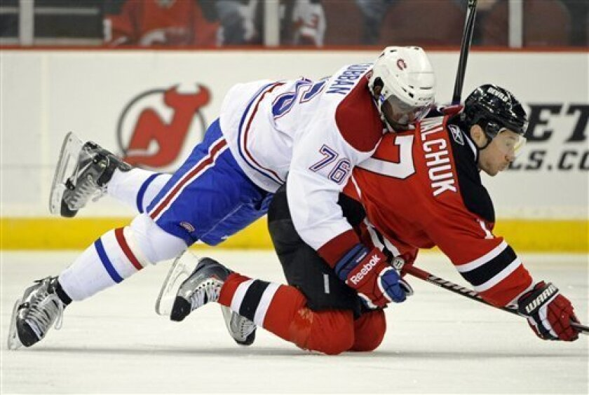Montreal Canadiens' P. K. Subban (76) takes down New Jersey Devils' Ilya Kovalchuk during the first period of an NHL hockey game on Saturday, April 2, 2011, in Newark, N.J. (AP Photo/Bill Kostroun)