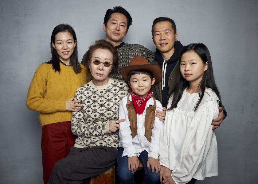 """Han Yeri, from top left, Steven Yeun, director Lee Isaac Chung, Yuh Jung Youn, from bottom left, Alan Kim, and Noel Cho pose for a portrait to promote the film """"Minari"""" at the Music Lodge during the Sundance Film Festival on Monday, Jan. 27, 2020, in Park City, Utah. (Photo by Taylor Jewell/Invision/AP)"""