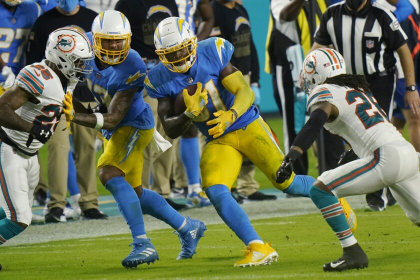 Chargers running back Kalen Ballage carries the ball during the second half of a 29-21 loss to the Miami Dolphins.