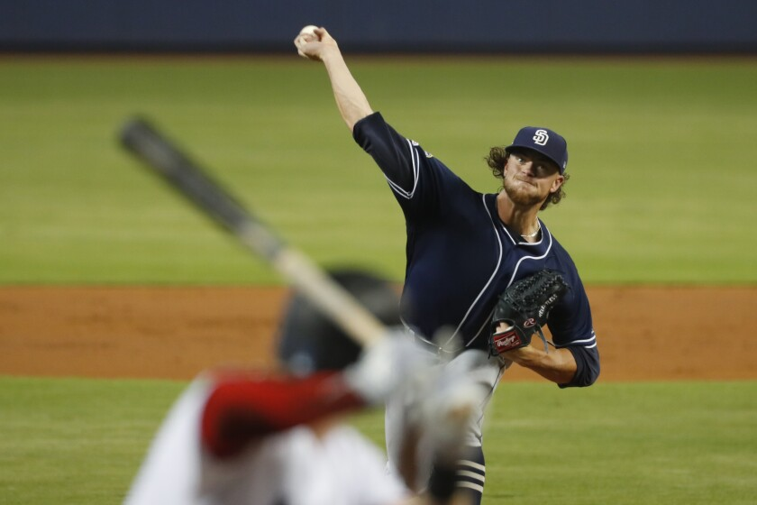 Padres' Chris Paddack pitches to Miami Marlins' Garrett Cooper during the first inning Wednesday.