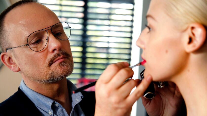 Peter Philips, creative and image director of Dior Makeup, demonstrates how to apply the new Dior Addict Lacquer Stick. He says he was inspired by Los Angeles as he created the new line of lip colors.