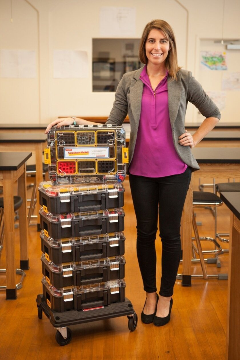 Caitlin Bigelow poses with Rokenbok products at the company's Solana Beach headquarters.