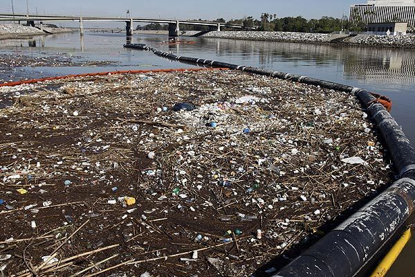 A trash boom keeps a massive refuse heap from flowing out of the Los Angeles River and into the Pacific Ocean. Storms often leave Southern California beaches littered with the region's trash. Full story