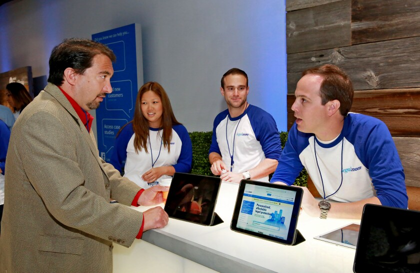 A small business owner gets advice at a LegalZoom booth in 2014 in New York.