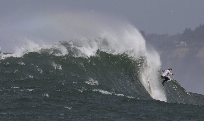 Mark Healey drops off a giant wave during the second heat of the Mavericks surfing contest Friday, Feb. 12, 2016, in Half Moon Bay, Calif. (AP Photo/Ben Margot)