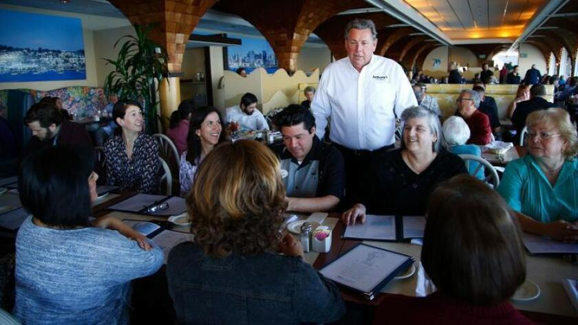Craig Ghio from Anthony's Fish Grotto welcomed a large group from the San Diego Zoo that was celebrating a retirement and the last day of the restaurant after 71 years on the bay. (Nelvin C. Cepeda/Union-Tribune)