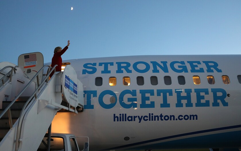 Hillary Clinton boards a campaign jet in Grand Rapids, Mich., the day before she lost the 2016 election to Donald Trump.
