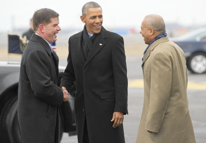 President Obama talks with Boston Mayor Martin Walsh, left, and Massachusetts Gov. Deval Patrick, both Democrats. Obama's latest change to the Affordable Care Act was requested by Democrats facing tough reelection campaigns this year.