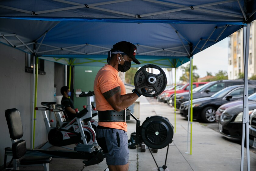 Garry Julian works out outdoors at Last Real Gym in North Park on Thursday.