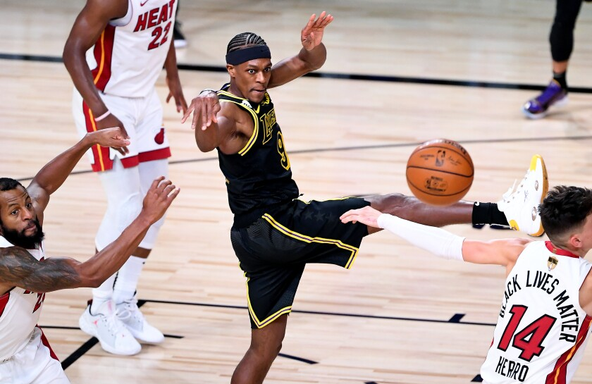 Lakers guard Rajon Rondo passes during the fourth quarter of a 124-114 victory over the Miami Heat.