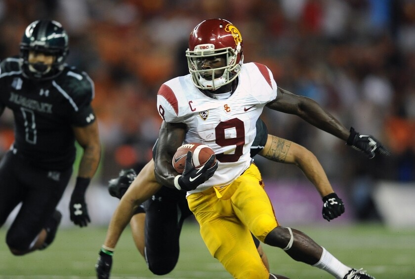 USC receiver Marqise Lee picks up yardage against Hawaii after a reception on Thursday night in Honolulu.