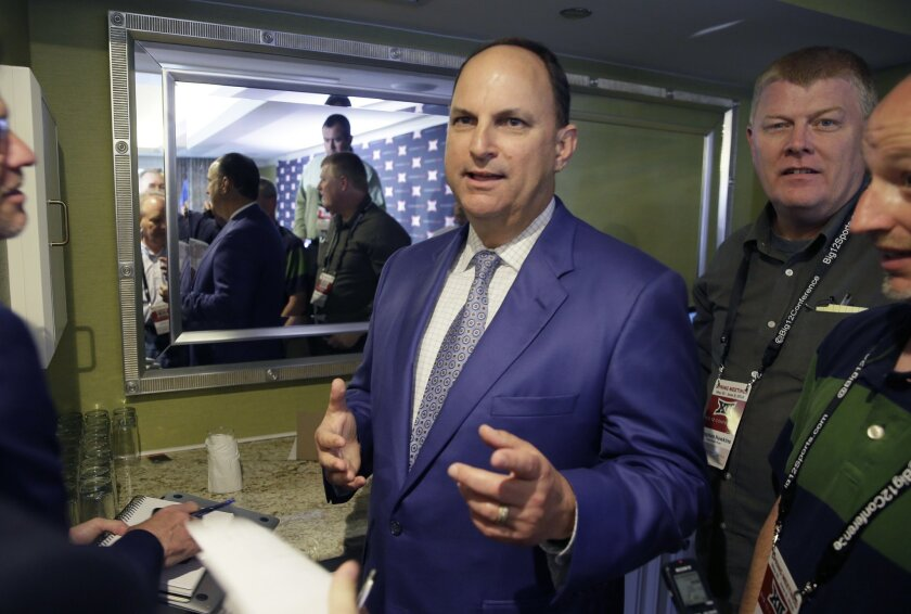Oklahoma athletic director Joe Castiglione speaks to reporters after the first day of the Big 12 sports conference meeting in Irving, Texas, Wednesday, June 1, 2016. (AP Photo/LM Otero)