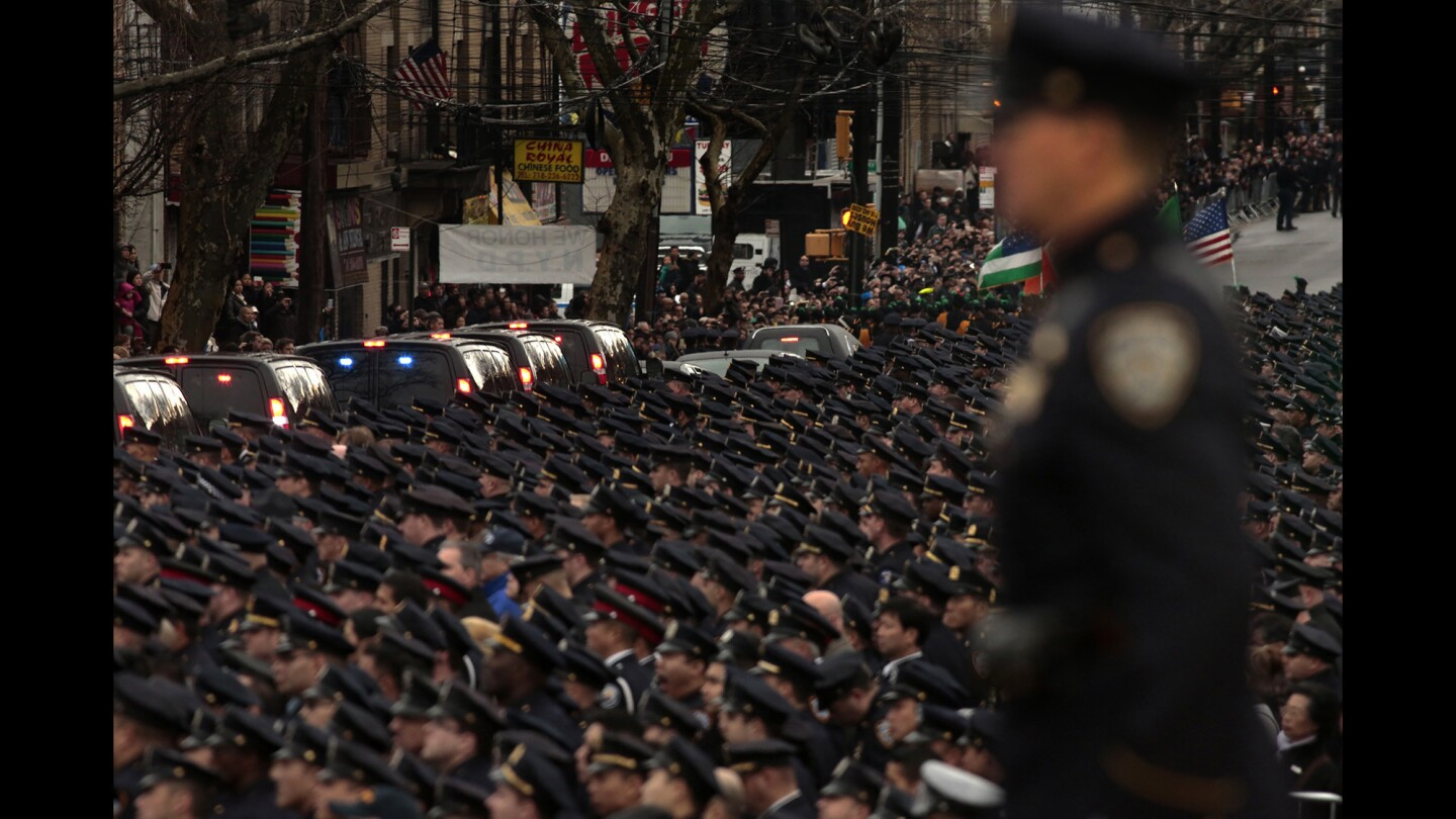 A sea of uniformed officers line the street in honor of police Officer Wenjian Liu, who was killed with partner Rafael Ramos on Dec. 20.