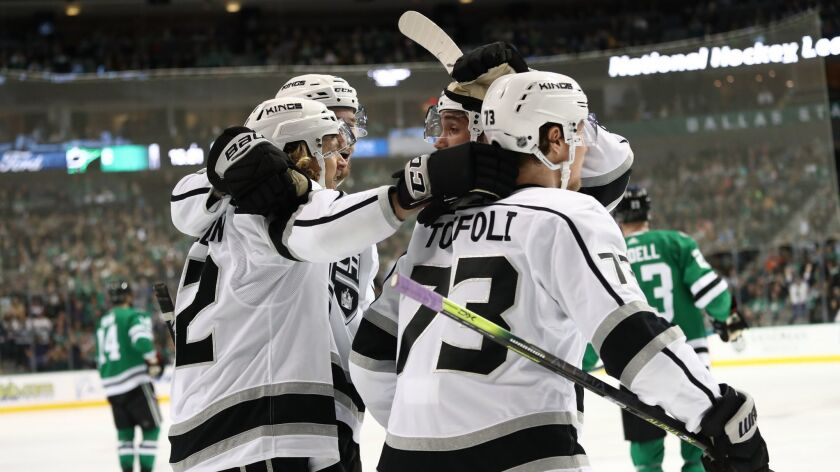 Tyler Toffoli (73) and other Kings celebrate Carl Hagelin's, left, goal against the Dallas Stars during the second period at the American Airlines Center. It was the eventual game-winner.