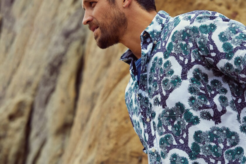 A man wears a Reyn Spooner shirt designed by woodcut artist Valerie Lueth and inspired by Joshua Tree National Park.