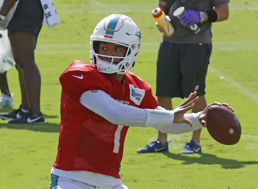 Dolphins quarterback Tua Tagovailoa sets to throw during practice.