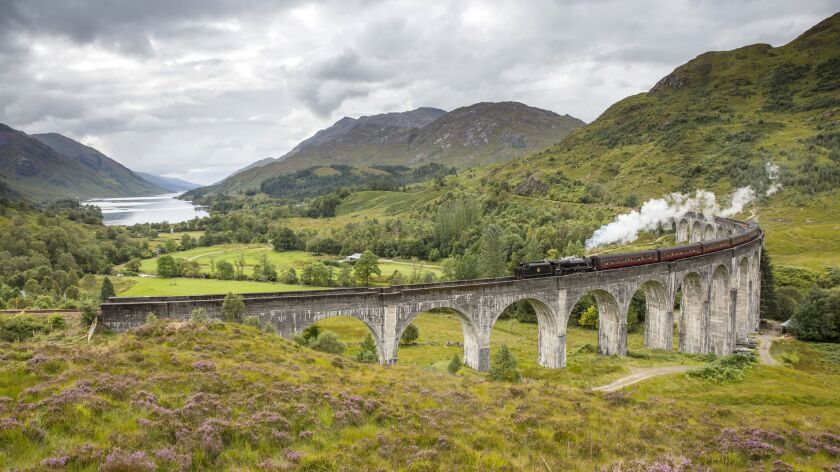 The Jacobite steam train passing over the Glenfinnan Viaduct at the head of Loch Shiel, Lochaber, Hi