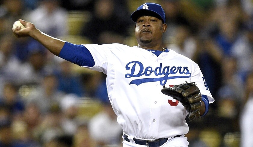 Dodgers third baseman Juan Uribe throws to first base to put out a Giants batter in the fifth inning Thursday night.