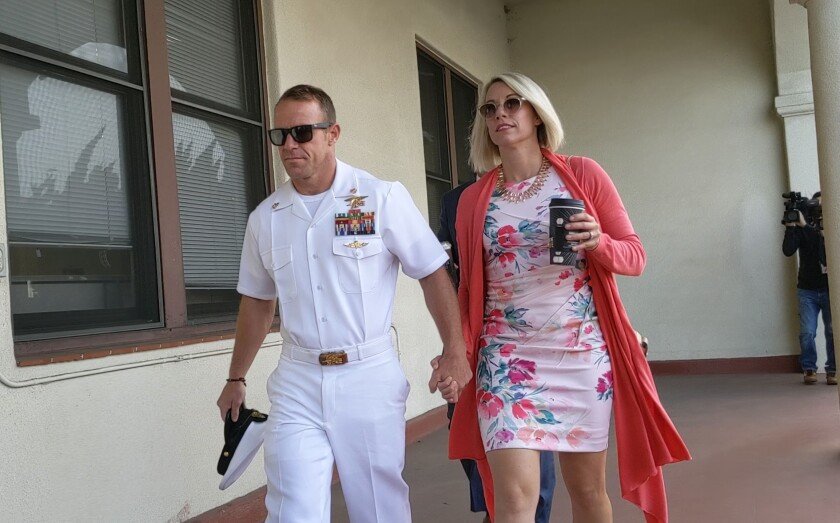 Navy SEAL Chief Edward R. Gallagher and his wife Andrea Gallagher at the Naval Base San Diego courthouse in July for closing arguments and jury deliberation in Chief Gallagher's war crimes murder trial. He was acquitted on most counts but convicted of posing in a photo with a corpse.