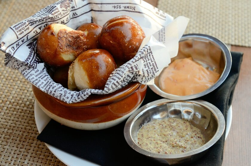 Veranda's Pretzel Bites, which are lightly salted and buttered, and served with spicy mustard and chipotle aioli dipping sauces.