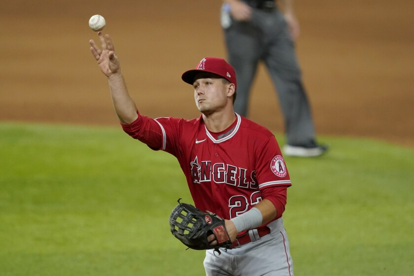 Angels second baseman Matt Thaiss throws to first for the out on a grounder by Texas Rangers' Jose Trevino.