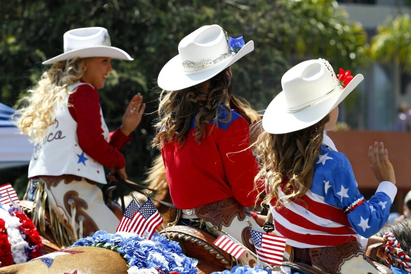 .Girls from with the Poway Rodeo Queens ride their horses down the route for Coronado's annual Fourth of July parade.