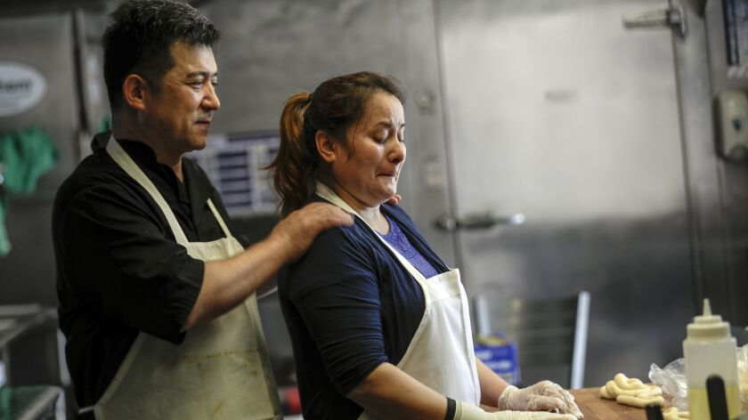 Two people in a restaurant kitchen