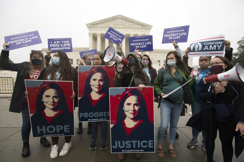 Supporters of Supreme Court nominee Amy Coney Barrett demonstrate outside the Supreme Court.