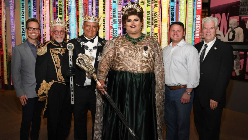 Joel Steward (Lambda Archives of SD board president); Michael Lochner, Emperor Mark Newsome, Empress Barbie Z. (all from The Imperial Court de San Diego); Drew Woodmansee (Community Advisory Council member), Bill Lawrence (SDHC executive director)