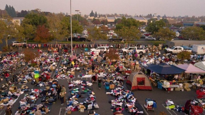 Fire evacuees sift through a surplus of donated items in a parking lot in Chico, Calif.