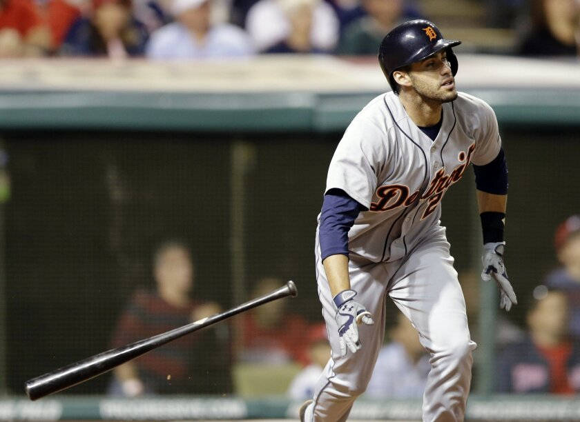 FILE - In this June 20, 2014, file photo, Detroit Tigers' J.D. Martinez watches his ball after hitting a three-run home run off Cleveland Indians relief pitcher John Axford in the eighth inning of a baseball game in Cleveland. A person with knowledge of the deal says Martinez has agreed to an $18.5