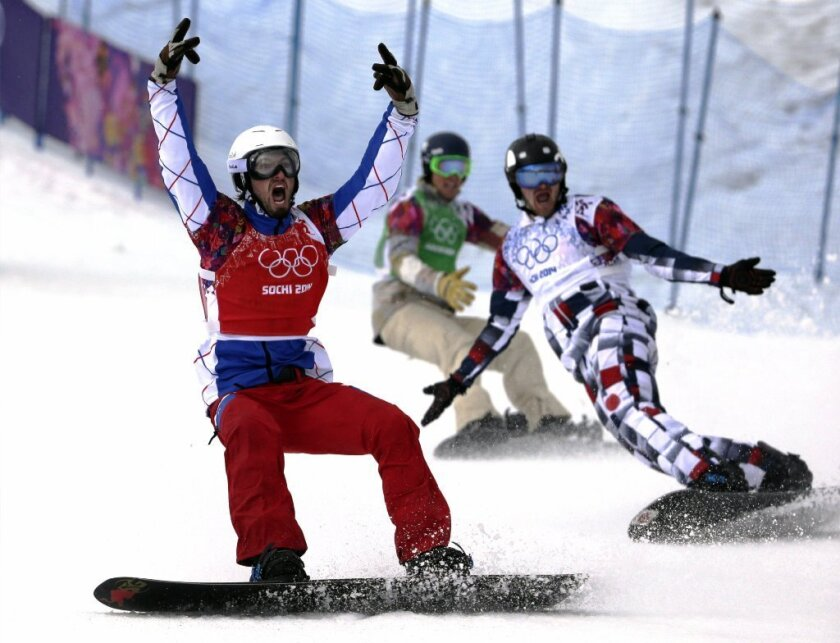 France's Pierre Vaultier celebrates his victory in the men's snowboard cross final at the 2014 Winter Olympic Games in Sochi, where many riders complained balmy weather had ruined the slopes. Beijing, which was selected to host the 2022 Games, will face similar challenges.