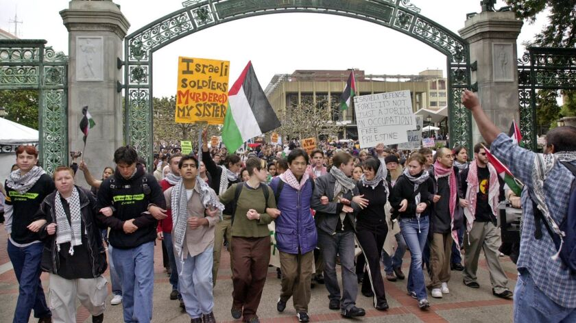 Pro-Palestinian demonstrators march through Sather Gate on the University of California, Berkeley campus.