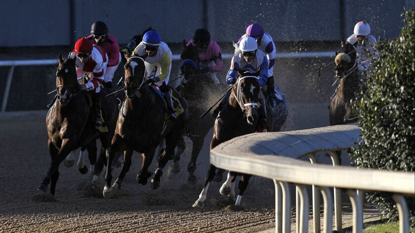 Omaha Beach, far left, with jockey Mike Smith, runs in the Rebel Stakes at Oaklawn Park in Hot Springs, Ark., on March 16.