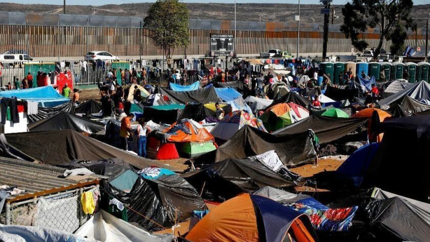 Members of the migrant caravan take shelter at the Benito Juarez Sports Center one block from the border in the Zona Norte neighborhood in Tijuana.