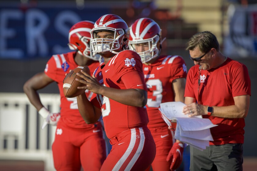 Santa Ana Mater Dei quarterback David Clark warms up before a game in Duncanville, Texas, on August 27.