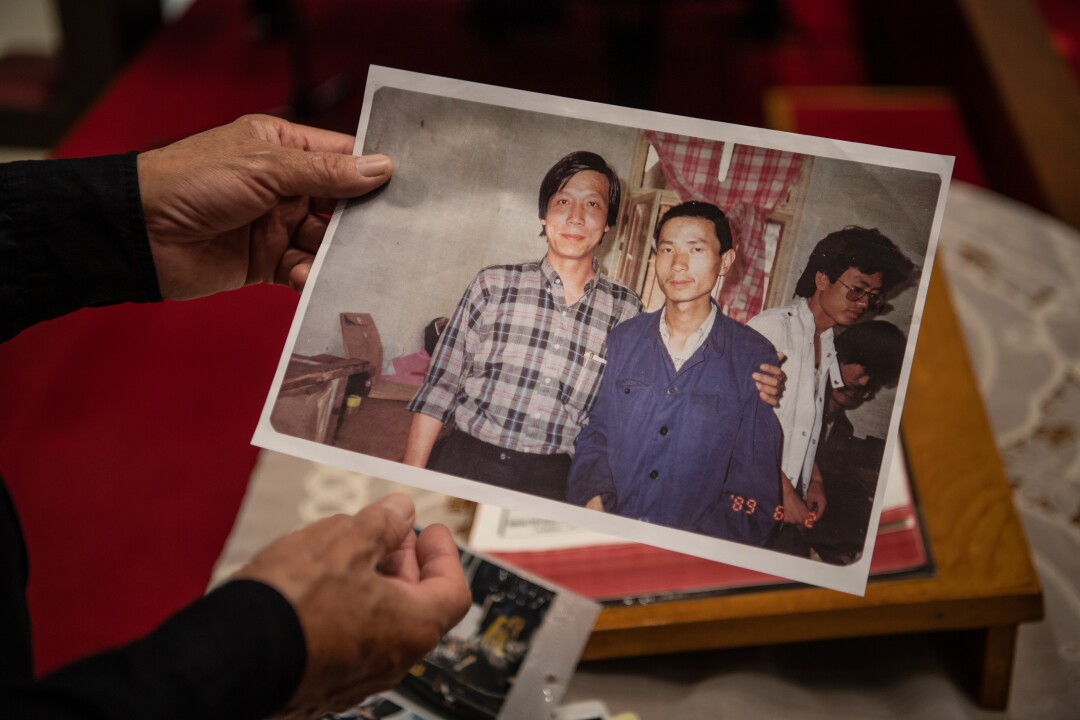 Reverend Chu Yiu-ming looks at a picture of himself with Chinese activist taken two days before the Tiananmen massacre.