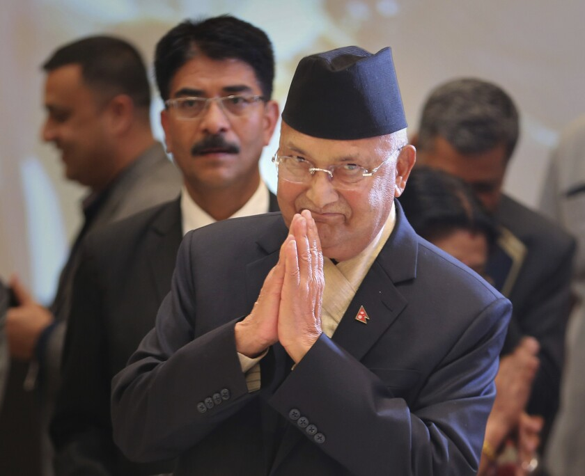 FILE- In this April 6, 2018 file photo, Nepalese Prime Minister Khadga Prasad Oli arrives for the inaugural ceremony of the India-Nepal business forum in New Delhi, India. Oli could be forced out of office within weeks amid an internal tussle for power within his governing party following his sharp rhetoric on neighboring India and as Chinese influence grows in Nepal. (AP Photo/Altaf Qadri, File)