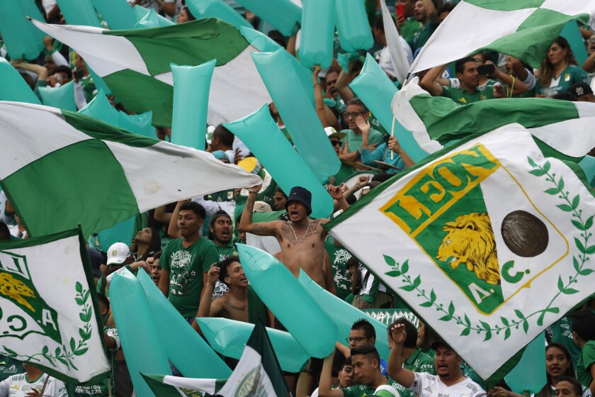 Fans of Leon cheer for their team prior to the final Mexico soccer league championship match against Tigres in Leon, Mexico, Sunday, May 26, 2019. (AP Photo/Eduardo Verdugo)