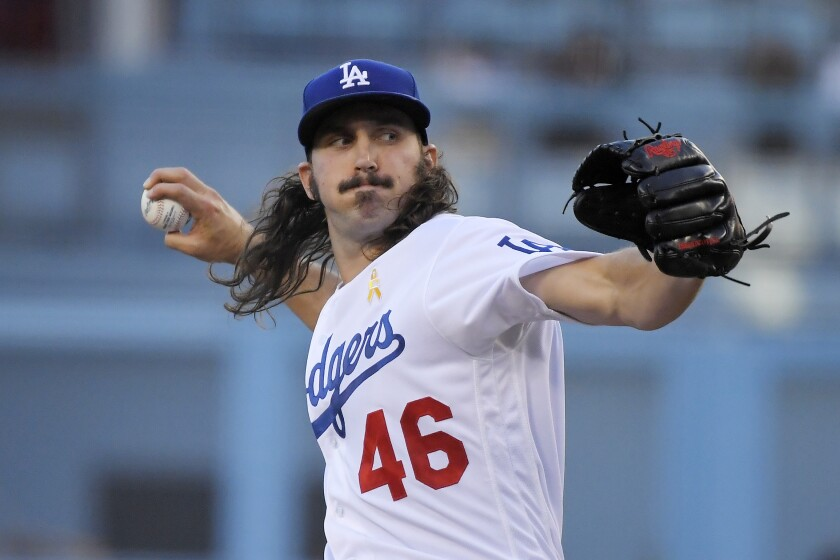 Dodgers pitcher Tony Gonsolin throws against the Giants on Sept. 7.