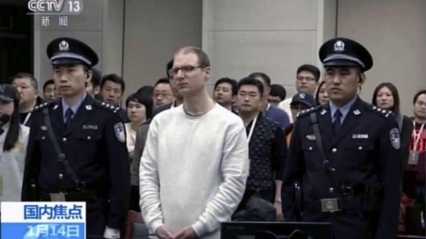 In this image taken from a video footage run by China's CCTV, Canadian Robert Lloyd Schellenberg att