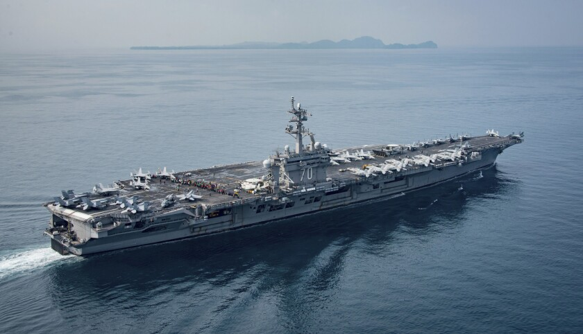 The U.S. aircraft carrier Carl Vinson transits the Sunda Strait between the Indonesian islands of Ja