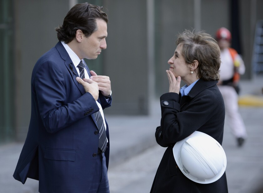 Mexican journalist Carmen Aristegui, shown talking with Pemez Chief Executive in February 2013, has been fired by her radio station.