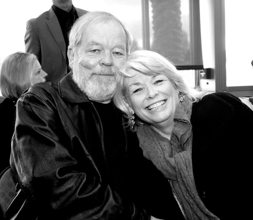 Michael Grant with his wife, Karen, in 2013.