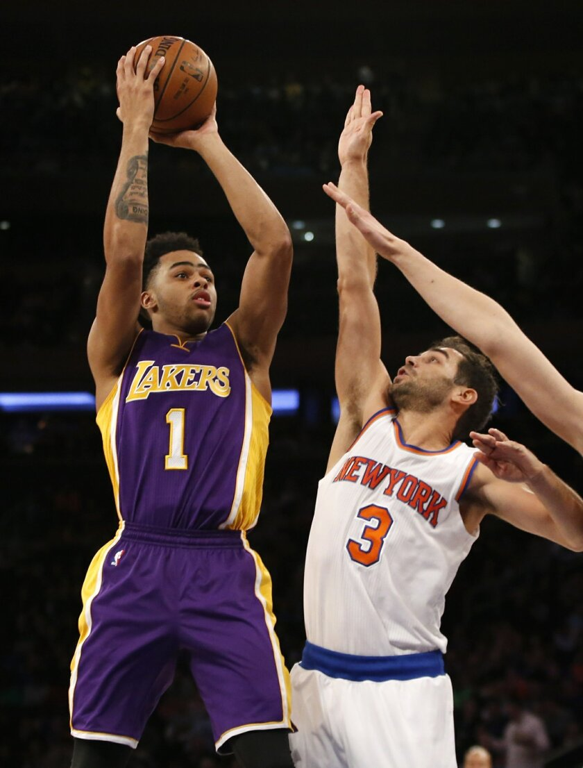 Los Angeles Lakers guard D'Angelo Russell (1) looks for a hole with New York Knicks guard Jose Calderon (3) defending in the first half of an NBA basketball game at Madison Square Garden in New York, Sunday, Nov. 8, 2015.  (AP Photo/Kathy Willens)