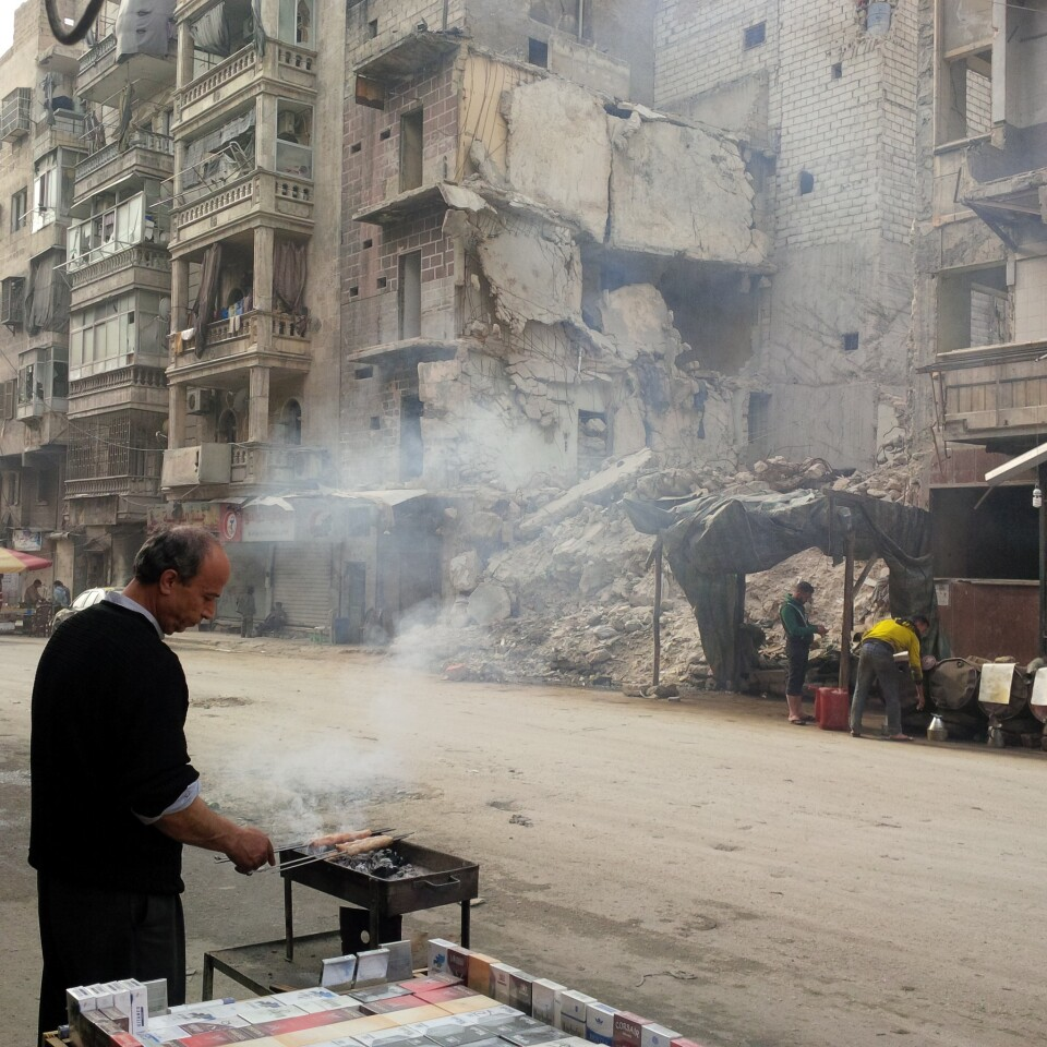 In Aleppo, Syria's largest city, a kebab vendor works in the midst of a destroyed building. As Syria's war rages on, Aleppo is a city under gradual demolition, with a shrinking civilian population struggling to survive.
