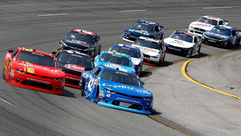 NASCAR driver Kyle Larson in the No. 42 Credit One Bank Chevrolet leads Justin Allgaier and the field through a turn during the Xfinity Series race Saturday.